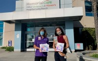 """GIOVANNA QUEVEDO, right, is the author of """"A Kid's Guide to Radiation Therapy, with staff member from Miller Children's & Women's Hospital, where they have copies of her book."""