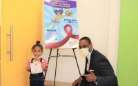 IKE MMEJE, chief operating officer, Miller Children's & Women's Hospital Long Beach brings an inspirational message of hope to Zaya, 4, who is battling sickle cell disease as part of Flames of Hope Project.