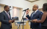 NEW TRUSTEE UDUAK-JOE NTUK is sworn in by Long Beach Councilman Rex Richardson as wife Tunua Thrash-Ntuk stands by.