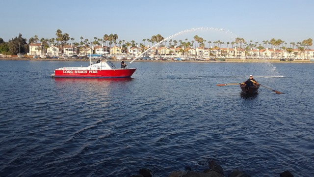 THE FINAL SENDOFF – In the tradition of Long Beach Lifeguards, those memorialized guardians are united in death, as in life, with the sands and sea.